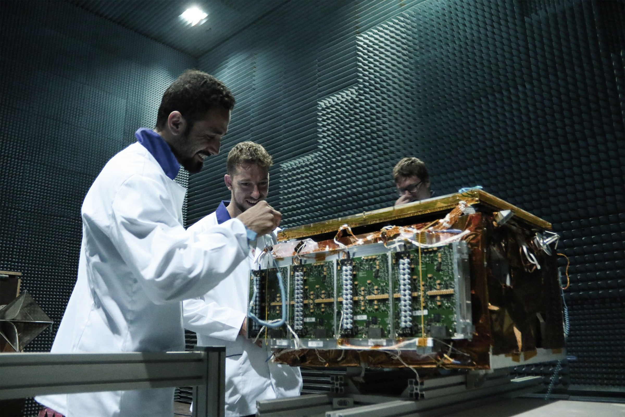 ICEYE engineers in an anechoic chamber with ICEYE hardware