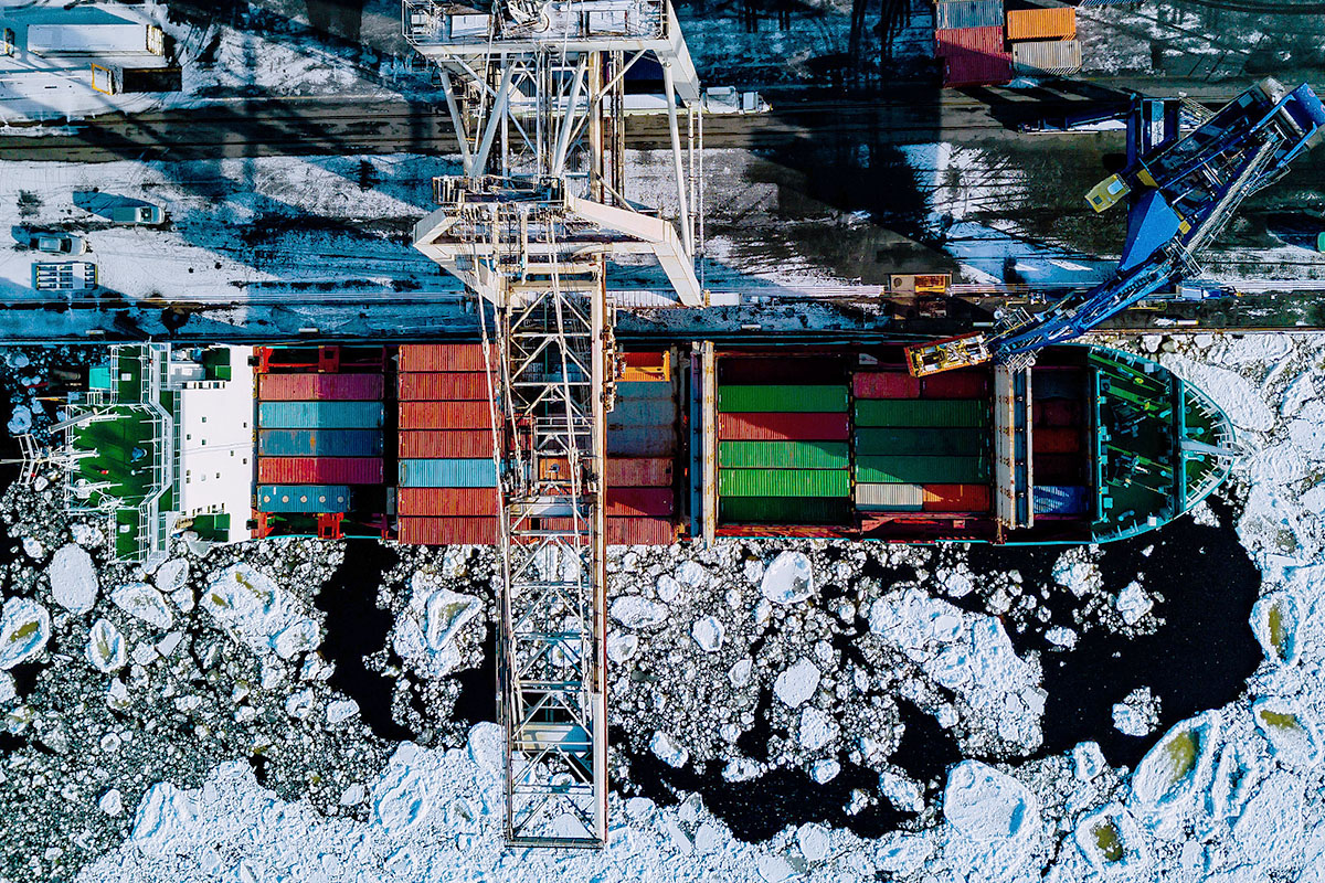 vessel-loading-container-yard-sea-ice